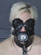 Amateur blonde sub in leather face bondage gagged